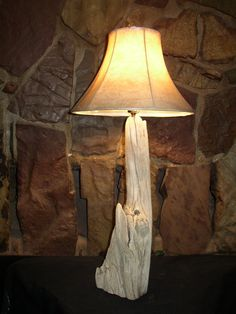 One of a kind piece of Montana ponderosa pine driftwood cut and sanded on the bottom to make a beautiful lamp. This lamp is made from a solid piece.
