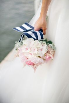 pale pink bouquet wrapped up in stripes |  Photography by jodysavagephotography.com |  Floral Design by couturefleur.net |  Read more - http://www.stylemepretty.com/2013/07/17/nautical-inspired-photo-shoot-from-jody-savage-photography/