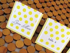Yellow, gray, and white polka dot escort cards for wedding
