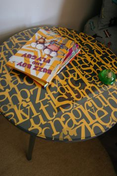 """I painted a cheap 30"""" table from Walmart.  Added scrap book paper with decoupage and poly.  Perfect for a little boys room!  Total cost was $0.  They were leftover materials from the matching dresser I did!"""