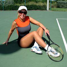 Sweet sporting Pantyhose while playing tennis.