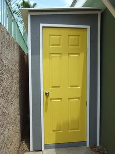 cute shed with yellow door