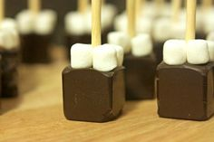 Hot Chocolate on a Stick:  Chocolate shavings, cocoa, powdered sugar, mini marshmallows and a square ice cube tray.  Stir into hot milk