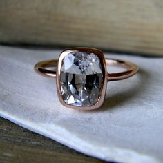 White Saphire Cushion Rose Solitaire ring on Etsy by One Garnet Girl. Love this!