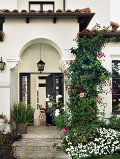 Bougainvillea climbs the exterior of this Spanish Revival bungalow, situated in a quiet neighborhood of Los Angeles.