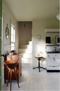 Kitchen with stairs.