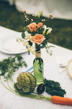vegetable + floral centerpieces, photo by Parker Young http://ruffledblog.com/backyard-tampa-wedding #weddingcenterpiece #weddingideas