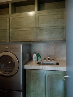 Saw this on HGTV website. For a laundry room...pretty sweet