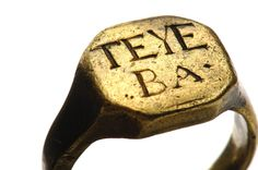 "Gold ring recovered from the wreck of the pirate ship Whydah. Some believe the cryptic letters are the abbreviation for a Welsh ""good luck"" wish. Others speculate that they may be of African origin. Another theory has it that the ring once belonged to a Royal Navy seaman named Teye, who later turned pirate. Photo by Bill Curtsinger ©National Geographic"