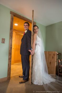 Michele & Chris decided not to have a first look before their wedding ceremony.  Instead they did a doorway look, so they could have photos together without seeing each other prior to getting married!  Photo courtesy of Aesthete Studios.