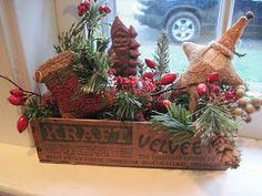 arrangement in an old wooden cheese box