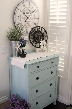"""Love the simple little arrangement of grasses (lavender?) in the tin """"vase"""" with the sea star. It would be so easy to repaint an older dresser to create this look. Chic Furniture, Beach Cottages, Clock, Blue, Refinished Furniture, Dresser, Paint Colors, Bedroom, Gray Paint"""