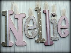 Decorative wooden letters perfect for a baby nursery.