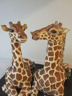 Bride and groom giraffe wedding cake