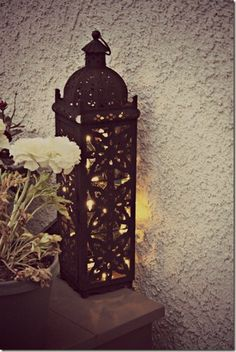 Lovely outdoor lighting using lanterns and solar Christmas lights.
