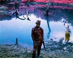 Infra War    Richard Mosse via Co.Design    War photographer Richard Mosse spent his time in the Democratic Republic of Congo shooting on Kodak Aerochrome film originally designed to help pilots spot camouflage, bathing surreal scenes of conflict in cotton-candy colors.