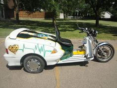 Hey Packers fans, time to break open your piggy bank and ante up for this beauty- half Geo Metro, half motorcycle, all sexy!