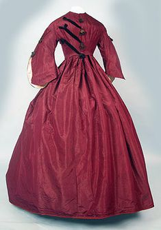 1860s maroon silk gown with black braiding on the bodice.