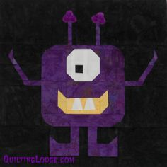 Little Mister Monster Block - One of the cutest and spookiest quilt blocks of the season can made easily with this paper piecing pattern from @Quilting Lodge. Put this adorable monster on your kid's trick or treat bag, or use it to make a fun Halloween quilt pattern.