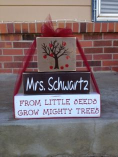 Personalized teacher principal appreciation wood block set stacker from little seeds grow mighty trees end of year classroom gift. $19.95, via Etsy.