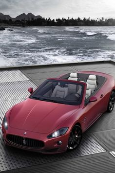 ♂ red car by the water