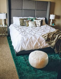 OBSESSED with @caravb  bedroom update! Featuring our Kuma Rug, Kenza Pouf, Asher Side Tables, and Neya Pillow #landgathome