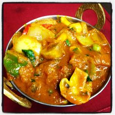Kadhai Mushroom - Mushroom cooked with fresh tomatoes, onions and bell pepper in spices.  http://www.himalayanrestaurant.com/dish/kadhai_mushroom.php