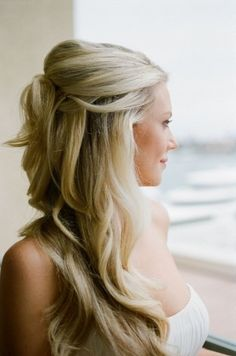 Pretty wedding hairstyle for long hair - Pinned back with pretty waves