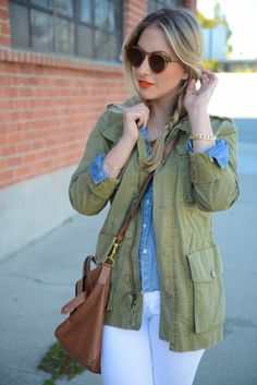 Denim shirt + olive jacket + white jeans + cognac accents + bright orange lipstick.