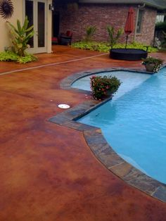 Stained concrete pool deck.  I think this color is Pinto by Proline.  Really liking this! pool decks and patios, concrete pool decking, concrete pool decks, stained pool deck, pool stained concrete, pool concrete stain, concrete stain pool, concrete stain patio, cement pool patio