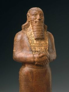 Statuette of an Assyrian king, 9th century BCE, amber with gold