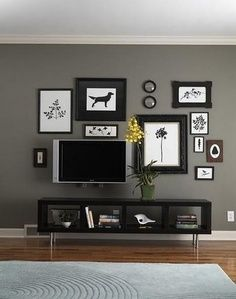 A clean and classy TV wall, with no messy wires. I like the way the TV isn't the focus of the wall, makes it functional and beautiful when not in use.