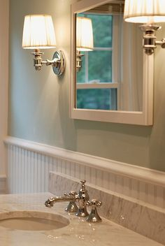 sconces are up, will replace the mirror in the future, wall color is Benjamin Moore Palladian Blue