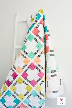 In Modern Quilts Block by Block readers will find 12 quilt projects using just one repeating block design. Find basic blocks along with some new designs in these striking modern quilts. Traditional blocks get a modern update with the use of color and design. Both the beginner and novice will enjoy quilting up these quilt patterns. Affiliate link.