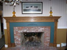 Old Village Paints ~ This is one of the houses fireplaces. It was bordered in wood and painted Cupboard Blue. The bead board on the wall was from an early 1900's shed. I painted it Old Sturbridge Mustard, now called Old Village Mustard. Edward Bozenski