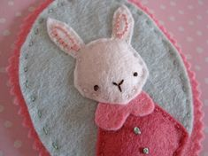 Charming Felt bunny on etsy, something about animals in clothes fascinates me.