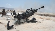 Soldiers from 3rd Howitzer Section, Alpha Battery, 2-8th Field Artillery fire the M777 at COP Wolverine in Zabul Province, Afghanistan.