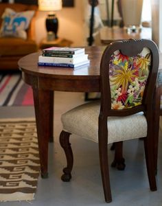 Crewel Embroidery Chair Upholstery:  Amanda Brown (Spruce) upholstered the chair using her mother's embroidery work from the 1970s; presented on Design Sponge.
