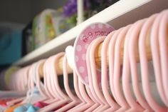 Use labels to designate clothing sizes in a child's closet.