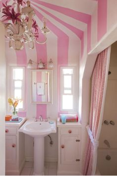 Pink and white tented stripe bathroom... Love the chandelier!