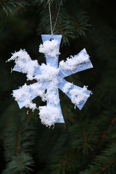simple snowflake ornament - fine motor activity. Cutting, pulling, painting, glueing.