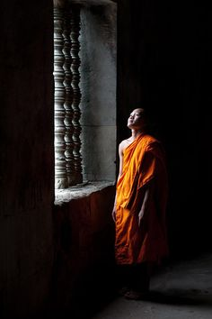 "Ben Edwards: ""The Buddhist monks of Cambodia show off their orange robes, and make a fine ­contrast with the ­surrounding of the stunning stone temples"""