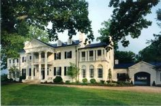 Plantation home with side approach to main entrance.