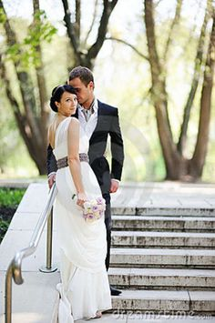 groom poses for photograghy | Bride And Groom Posing Outdoors On Wedding Day Stock Photo - Image ...