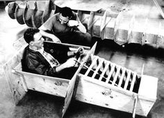 Englishman Len Terry looks on while Dan Gurney tries out a mock-up cockpit of what would become his F1 Eagle. He went on to win the 1967 Belgian Grand Prix. It thus became the first and only car produced in America to win a Formula 1 race in the modern era. From DAN GURNEY'S EAGLE RACING CARS, by John Zimmerman. (AAR Archives)