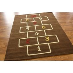 I totally want this hopscotch area rug and not just for my kids.