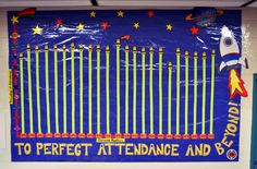This school used bright colors and a rocket theme to attract students to their board.