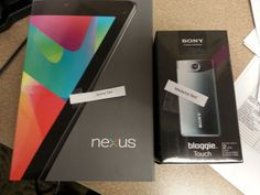 The fabulous grand prizes for the teen Summer Reading Game 2013!  A Sony Bloggie camera and a Nexus tablet.