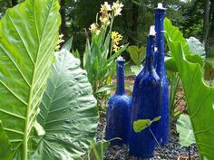 The Blue Bottles Fountain. Wait till you see it at night with uplighting. Striking in any Landscape. Southern Grace, The Water Feature Experts.