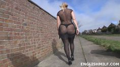 Big ass walk public street English milf in see through fishnet dress, thong, black stockings and heels. Public flashing exhibitionist exhibitionism public arse butt booty flash Uk wife from England.